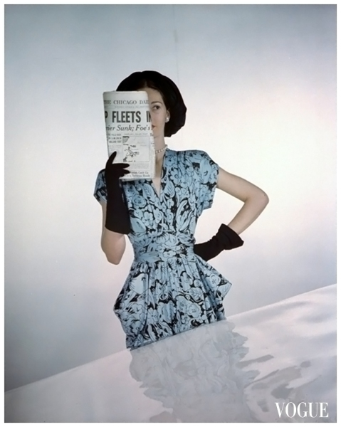 Vogue - January 1945 Constantin Joffé Model wearing bound-midriff dress of rayon jersey by Adele Simpson