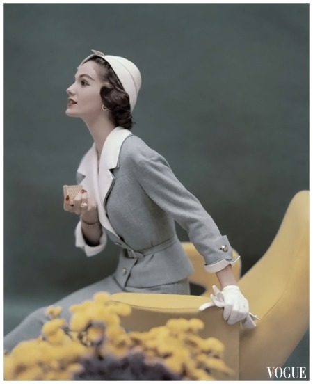 Vogue Mar 1957 Model in blue George Carmel suit with white lapels holding gold cigarette case Photo Karen Radkai