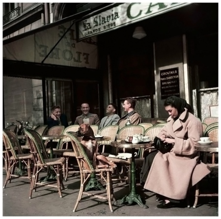 Alla and her dog sitting at Cafe de Flore, photo by Robert Capa, Paris, 1952