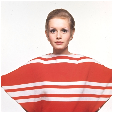Model Twiggy wears a Grès beach cover-up made of Racine jersey fabric Accessocraft earrings; Fabergé make-up and hair by Carita Photographed by Bert Stern, Vogue, April 1967