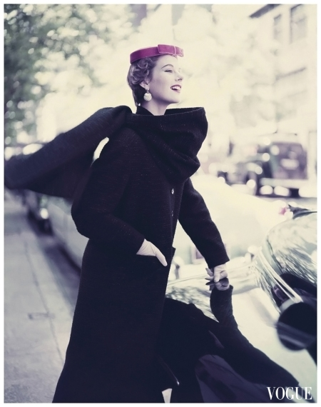 Model wearing narrow long wool woven black coat with a stole and tambourine hat 1953 Roger Prigent