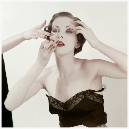 Photo Herbert Matter Model demonstrates how to apply Coty %22Finger Blend%22 make-up. Circa April 1950