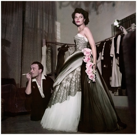 Robert Capa, [Actress Geraldine Brooks trying on a dress at the fashion house of Emilio Schuberth, Rome], August 1951. © Robert Capa-International Center of Photography-Magnum Photos
