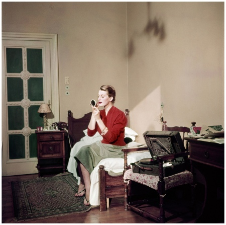 Robert Capa, [Capucine, French model and actress, in her hotel room, Rome], August 1951. © Robert Capa:International Center of Photography:Magnum Photos