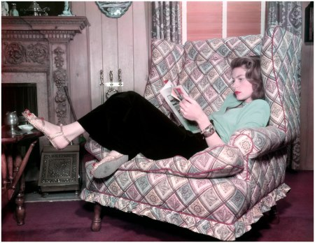 Lauren Bacall (Betty Jane Perske) lying on an armchair and reading a magazine. 1940s. (Photo by Mondadori Portfolio via Getty Images)