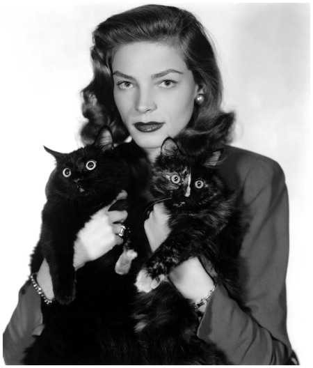 Lauren Bacall From the forties, the future Mrs. Bogart poses with two black cats Rex