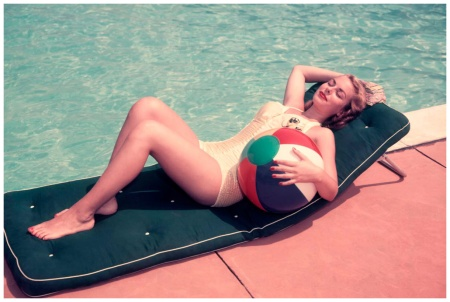 Woman Sun Bathing On Green Mat By Edge Side Of Pool Water Recline Holding Beach Ball By Her Side Relax 1950 Photo H. Armstrong Roberts, Retrofile : Getty Images