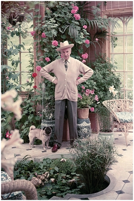Cecil Beaton with his pug in the Winter Garden, Reddish House 1961