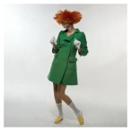 Model in a green coat, white gloves, white socks and yellow patent leather shoes, all by CourrËges. The model also wears a red dutch-boy wig 1969 Photo Bert Stern