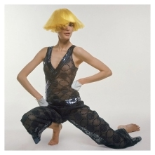 Woman in Yellow Wig and Courreges Jumpsuit