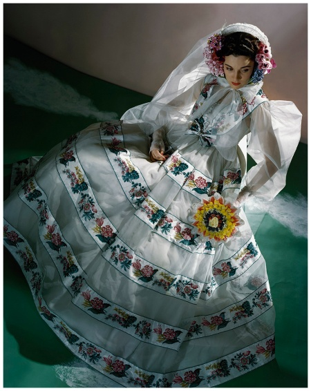 Model wearing a organdy bonnet framed with flowers, and a billowing organdy, chintz-banded wedding dress Horst P. Horst, Vogue, June 1, 1940