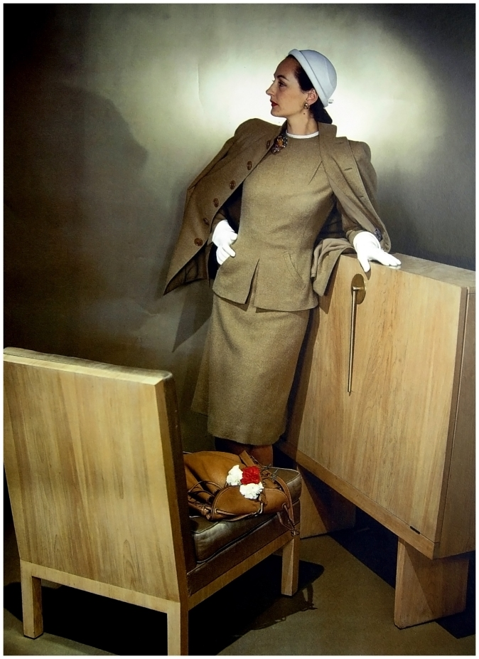 Model wearing Vera Maxwell's camel-colored back-buttoned suit 1944 Photo John Rawlings
