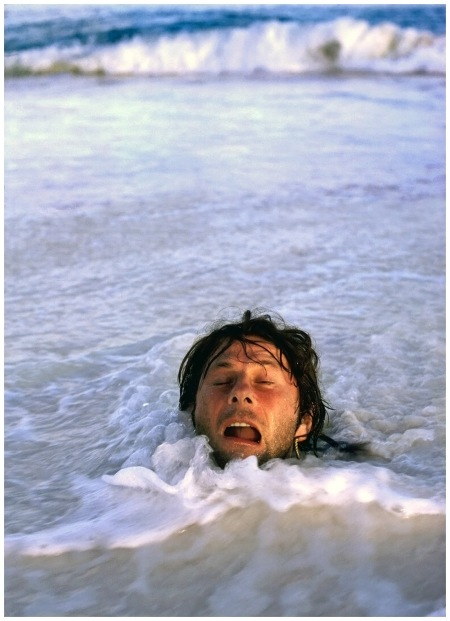 Polanski in Sand, Seychelles, 1976 Photo Harry Benson