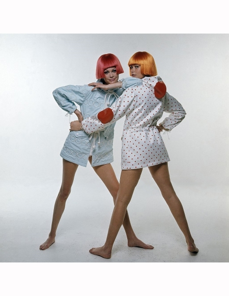two-models-wearing-courreges-on-the-left-model-in-a-powder-blue-hooded-beach-coat-and-a-red-dutch-boy-wig-to-the-right-model-in-a-white-with-red-polka-dots-beach-coat-and-red-elbow-and-hood-patches