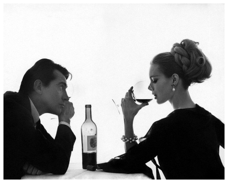 Man Watches Woman Sip Wine