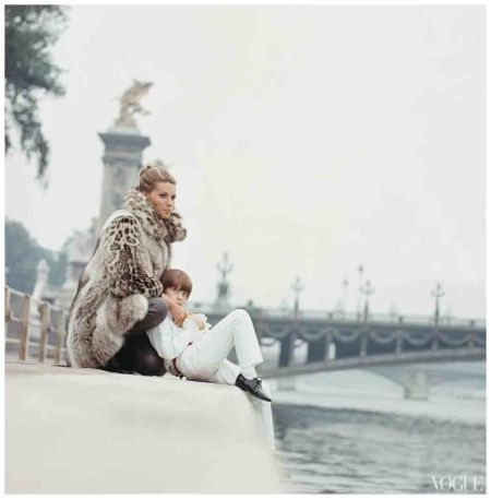 Madame Xavier Givaudan, wearing wolf and snow-leopard coat by Fernando Sanchez for Revillon, sitting on the banks of the Seine with a boy Arnaud de Rosnay 1968