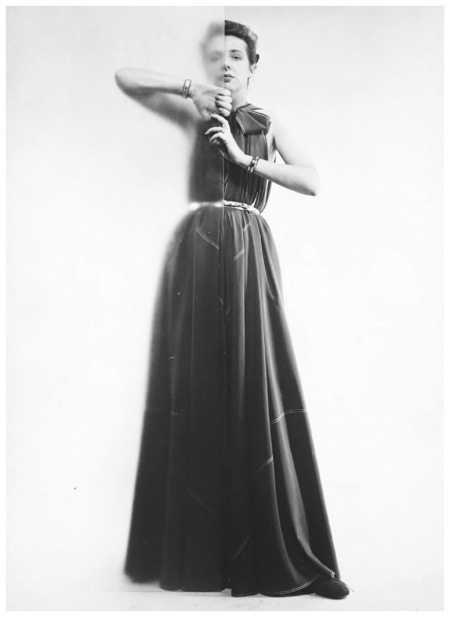 "Ms. McCardell in her ""Futuristic Dress"" cut only of triangles. Photo Erwin Blumenfeld 1945"