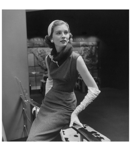Suzy Parker Inexpensive elegance is achieved by dressing up gray flannel sheath (Carolyn Schnurer,) 1950 - Photo Nina Leen