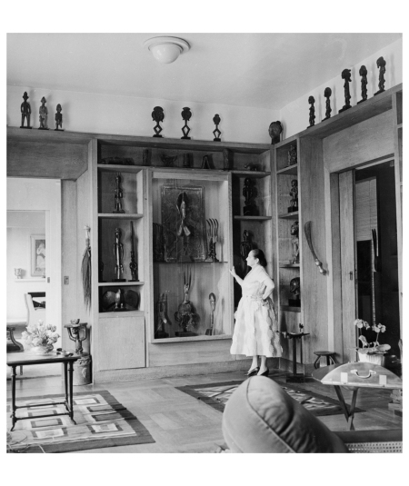 A fashion shoot for Bergdorf Goodman staged in the foyer of Helena Rubinstein's New York home at 625 Park Avenue, 1944. Photograph by John Rawlings