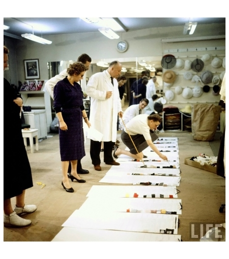Fashion designer Christian Dior (standing C w. pointer) working on new collection w. staff prior to showing