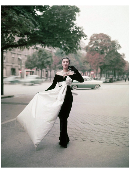 Paris, 1955 This black sheath evening gown by Christian Dior is one of the most striking fashions in the new Paris collections. It is narrowed to pencil slimness below the knees, accenting the top in the way of the French couture for fall and winter.