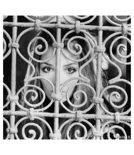 Talitha Getty looks out from behind an ironwork grille in the Palais de la Zahia. Circa January 1970 Photo Patrick Lichfield