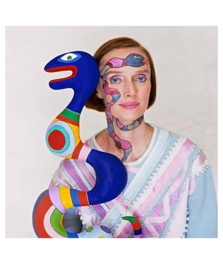 The French sculptor, painter and film-maker, Niki de Saint Phalle (1930 - 2002), photographed with one of her sculptures