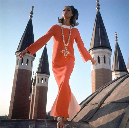 wearing a Christian Dior dress by minarets in Istanbul, Turkey.
