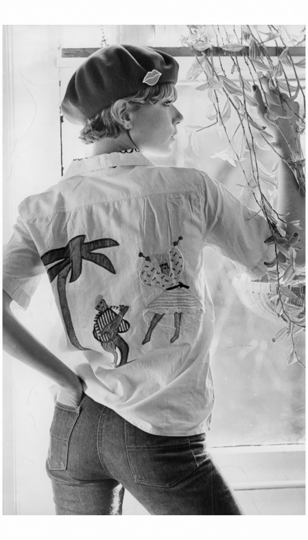 A Model In A Cream Cotton Fiorucci Shirt With Silk Embroidery Appliqués, 1976