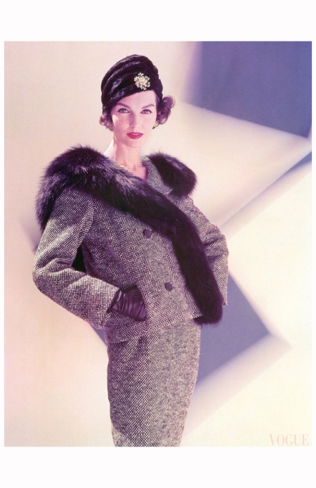 Joanna McCormick in black and white tweed suit with dyed fox collar by Ben Zuckerman, turban by Sally Victor with gold and diamond clip by Jean Schlumberger, photo by Karen Radkai, Vogue, Oct. 1956 cover oct 56