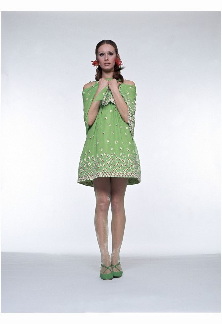 Model in short chiffon embroidered baby doll dress by Arnold Scaasi with discreet flower print paired with Christian Dior shoes, Beautiful Bryan stockings and James Douglas Goodson earrings. Circa April 1968 Photo Alexis Waldeck