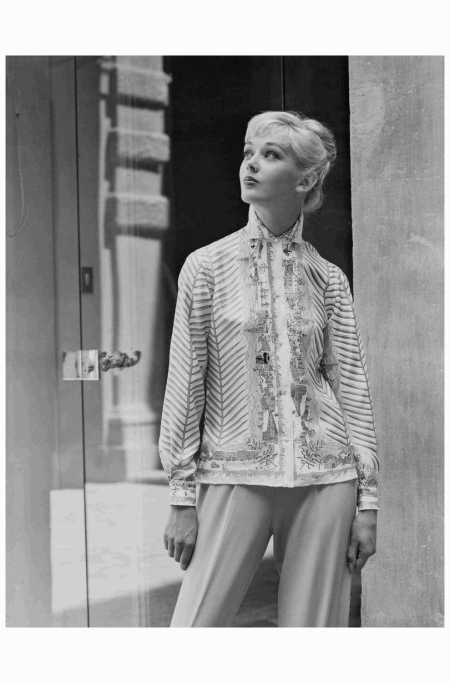 "Model wearing a printed silk shirt designed by Emilio Pucci. ""Cortina D'Ampezzo"" design. 1957"