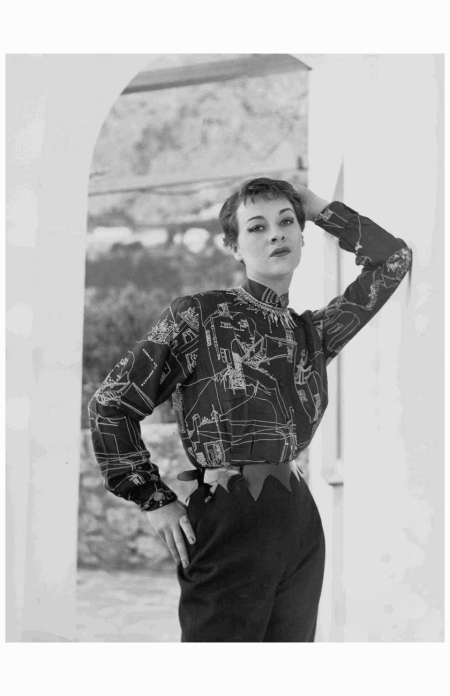 "Model wearing shirt, trousers, belt and necklace all by Emilio Pucci, 1950:1951. The silk shirt is printed with Pucci's design ""Scorci Capresi""."