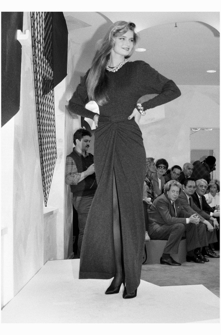 A Model Wearing A Crewneck Sweater And A Sarong Draped Gray Cashmere Skirt In The First Donna Karan Show, 1985