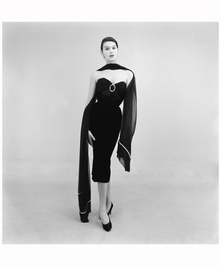A model wearing a full-length evening dress by Biki, Milan, 16th February 1956 Cameraphoto