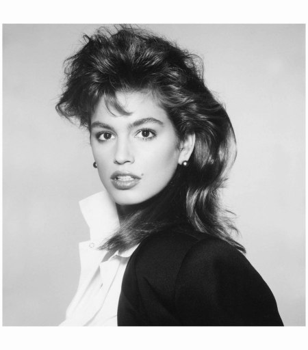 Cindy Crawford, jacket by Giorgio Armani, shirt by Agnes B., Mikimoto pearl earrings, New York, 1987 Photo Richard Avedon