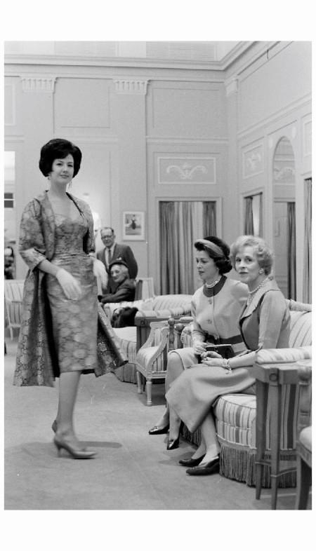 Designer, Sophie Gimbel, of Saks Fifth Avenue, viewing model w. customer Nov 1960 Peter Stackpole