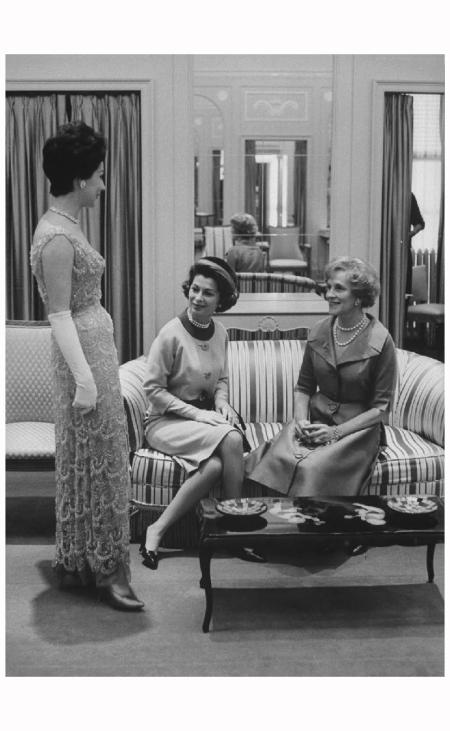 Designer Sophie Gimbel (R) of Saks Fifth Avenue viewing model Nov 1960 Peter Stackpole