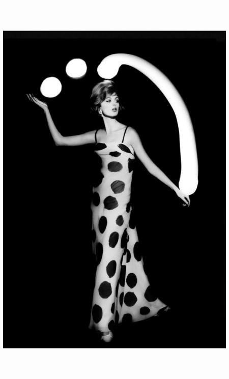 Dorothea McGowan juggling white light balls, Paris, 1962 (in a dress by Jean Dessès) Photo William Klein