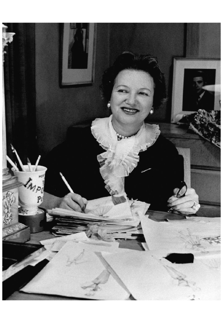 Dress designer Mollie Parnis working on dress sketches 1955 Photo Nina Leen