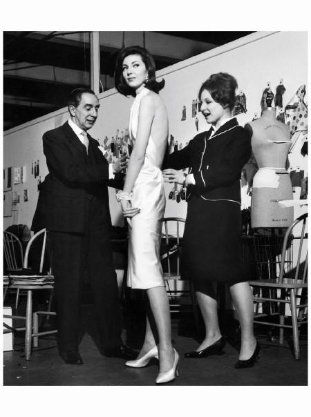 Fashion designer Norman Norell (L) assisting student designer Deanna Cohen (R) fit prize-winning dress she designed 1960 Photo Joe Scherschel