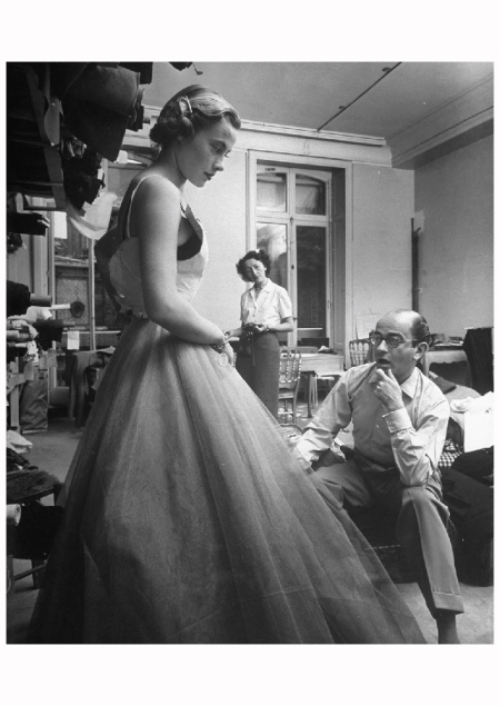 French fashion model Christiane Richard (L) wearing evening gown as designer Jean Desses tries to make adjustments 1950 N R Farbman