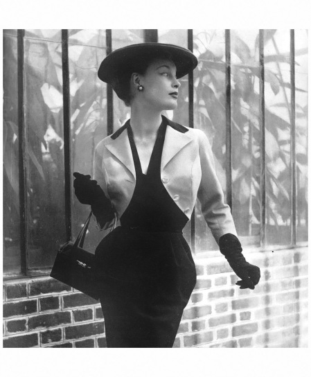 Model in narrow black wool dress worn under bright yellow braided silk bolero with black lapels, by Jean Dessès, 1953 Photo Philippe Pottier