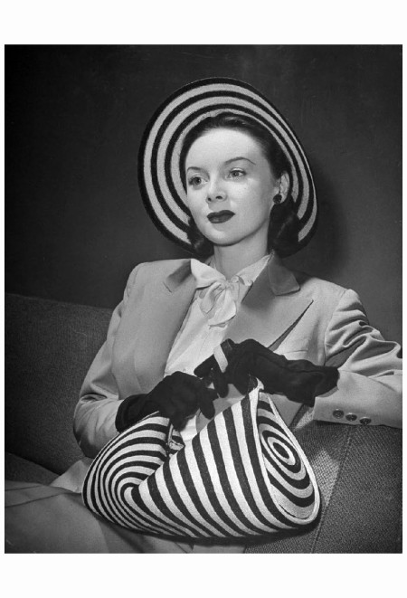 Model Michele Fallon wearing John-Frederics striped straw hat with matching handbag 1944 Photo Nina Leen
