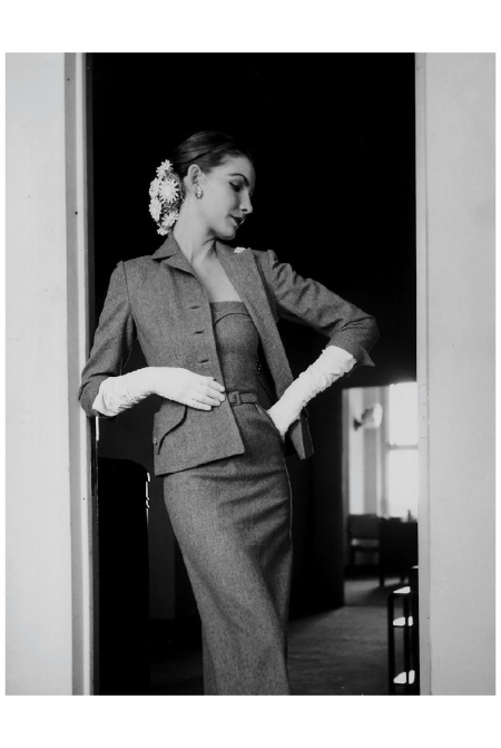 Model wearing slim strapless flannel dress & matching tailored jacket by Mollie Parnis 1951 Photo Gion Mili