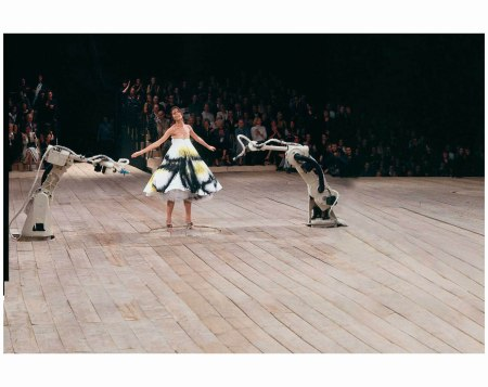 Trapeze dress worn by Shalom Harlow is spray-painted by two robots from an Italian car factory for the dramatic finale of 1999's No.13 show
