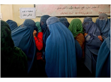 Afghans line up to register to vote for Presidential elections at a center run by the Afghan Independent Electoral Commission in Shah Shaheed, Kabul, Afghanistan, March 25, 2014 LYNSEY ADDARIO
