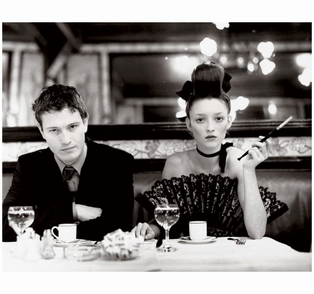 Nick moran and Audrey Marnay Chanel at Brasserie Lipp Arthur Elgort Vogue Mar 1999