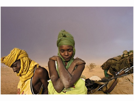 Soldiers with the Sudanese Liberation Army wait for their truck to get unstuck from mud, August 2004 Lynsey Addario