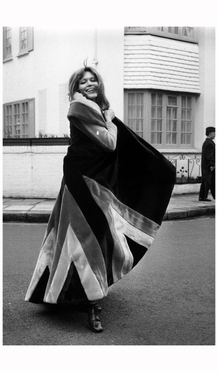 Amanda, a model wearing a fake fur coat, designed by Ossie Clarke, on the King's Road in London Frank Barratt